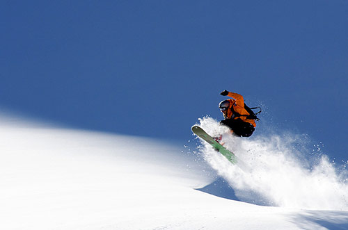 Snowboarder in Action Photos with Perfect Timing
