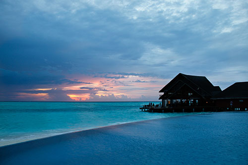 Anantara Dhigu Maldives Infinity Pool at Sunset